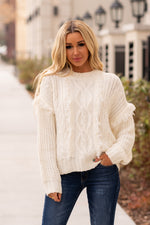 Hem & Thread   This fringe cable knit sweater paired with a skinny denim and tall boot has you ready for a winter night out.  Collection: Winter 2020 Color: Ivory  Neckline: Crewneck Sleeve: Long Sleeve Style #: 8377-IvoryWhite Contact us for any additional measurements or sizing.  Haley wears a size small top, a 25 in jeans and a small in tops. She is wearing a size small in this top.