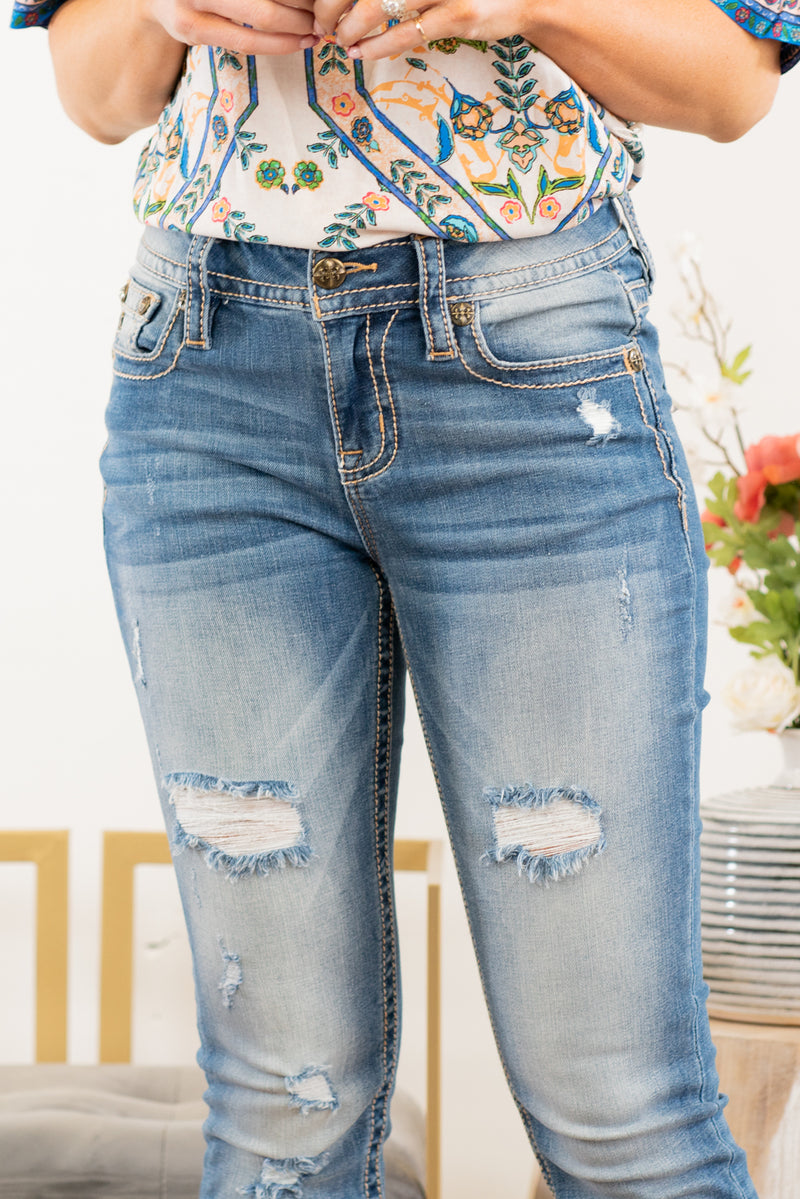 "Miss Me  The Heaven collection from Miss Me features a clean look with small embellished details. Look fierce in this pair of skinny jeans featuring a 5 pocket design, whiskering and distressing throughout. Collection: Spring 2021 Wash: Dark Blue Inseam: 30"" Skinny Cut Mid Rise, 8.75"" Front Rise 97% Cotton, 3% Elastane Classic Silver Rivets & Buttons Style #: M3636S17 Contact us for any additional measurements or sizing."