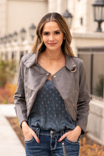 "Blu Pepper  Pair this jacket with silky camisole and a dark wash skinny.   Collection: Winter 2020 Color: Grey Neckline: Open with Zipper Sleeve: Long Sleeve 100% Polyester  Style #: EM6600-Grey Contact us for any additional measurements or sizing.  Mckenna is 5'10"" and 122 pounds. She wears a size small top, a 4 in jeans and a size 8.5 in shoes. She is wearing a size small in this top."