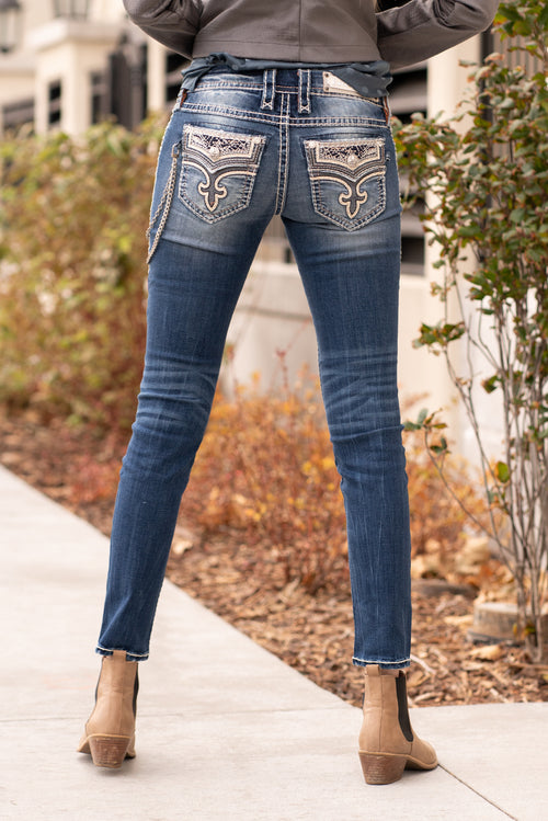 "Rock Revival Collection: Winter 2020 Sabri S203  Wash: Medium Blue Inseam: 33.5"" Straight Cut Mid Rise, 8.75"" Front Rise Embellished Reversed Fluer De Lis Pocket Style #: TJ2668S203 Contact us for any additional measurements or sizing.  Mckenna is 5'10"" and 122 pounds. She wears a size small top, a 4 in jeans and a size 8.5 in shoes. She is wearing a size 26 in these jeans."
