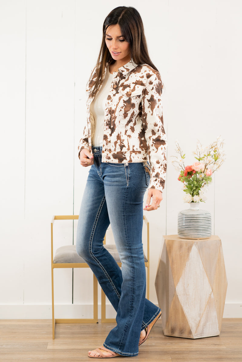 "Judy Blue Collection: Spring 2021 Color: White with Brown Cow Print Cut: Denim Jacket with Stretch 98% Cotton / 2% Spandex Stitching: Classic Button Closure with Two Pockets Style #: JB7806 , 7806 Contact us for any additional measurements or sizing.  Chloe is 5'8"" and 130 pounds. She wears a size 3 in jeans, a small top and 8.5 in shoes. She is wearing a size small in the jacket."