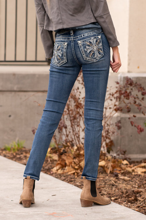 "Miss Me Collection: Winter 2020 Wash: Dark Wash Inseam: 30"" Inseam Sequin Trim and Rhinestone Rivets  Mid Rise, 8.75"" Front Rise Embellished Winter Cross Pocket Style #: M3703S Contact us for any additional measurements or sizing.  Mckenna is 5'10"" and 122 pounds. She wears a size small top, a 4 in jeans and a size 8.5 in shoes. She is wearing a size 26 in these jeans."