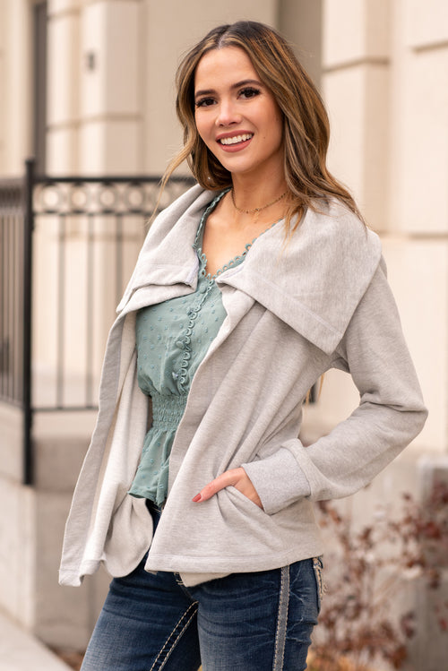 "Hem & Thread   Collection: Winter 2020 Color: Heather Grey Neckline: Open Neck with a One Button Closure Sleeve: Long Sleeve SELF: 55% COTTON 45% POLYESTER Style #: 8498-HeatherGrey Contact us for any additional measurements or sizing.  Mckenna is 5'10"" and 122 pounds. She wears a size small top, a 4 in jeans and a size 8.5 in shoes. She is wearing a size small in this jacket."