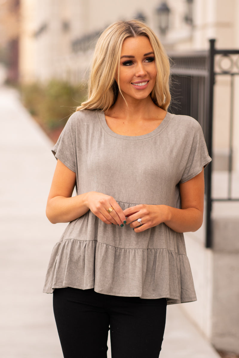 Escape by Blu Pepper  A comfortable and versatile top to pair with any denim.  Collection: Winter 2020 Color: Grey Neckline: Round Sleeve: Short Sleeve 95% Polyester 5% Spandex Style #: B0FT1055-Grey Contact us for any additional measurements or sizing.  Haley wears a size small top, a 25 in jeans and a small in tops. She is wearing a size small in this top.