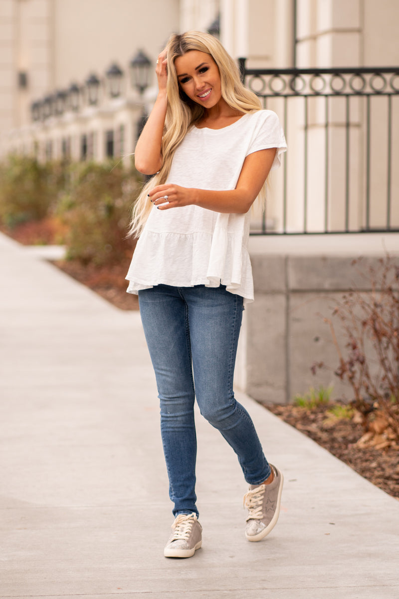 Escape by Blu Pepper  A comfortable and versatile top to pair with any denim.  Collection: Winter 2020 Color: Off White Neckline: Round Sleeve: Short Sleeve 50% Polyester 50% Modal Style #: B0FT1055-OffWhite Contact us for any additional measurements or sizing.  Haley wears a size small top, a 25 in jeans and a small in tops. She is wearing a size small in this top.