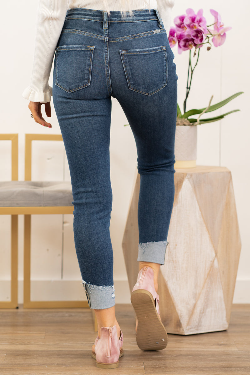 "KanCan Jeans Collection: Winter 2020 Color: Dark Blue Cut: Cuffed Skinny, 26"" Inseam Rise: High-Rise, 10"" Front Rise COTTON 98% POLYESTER 30% SPANDEX 2% Stitching: Classic Fly: Exposed Button Fly  Style #: KC8606D Contact us for any additional measurements or sizing.  Haley wears a size small top, a 1 in jeans, and a small in tops. She is wearing a size 24/1 in these jeans."