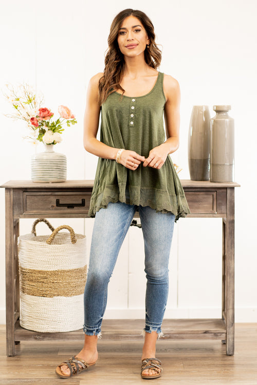 Miss Sparkling  Pair this tank with skinny jeans and strappy sandals for a perfect spring look.  Collection: Spring 2021 Color: Green Neckline: Round Neck Sleeve: Tank 60% Cotton 35% Polyester 5% Spandex Style #: D2050457 Contact us for any additional measurements or sizing.   Taylor wears a size 3 in jeans, a small top, and 8.5 in shoes. She is wearing a size small in this top.