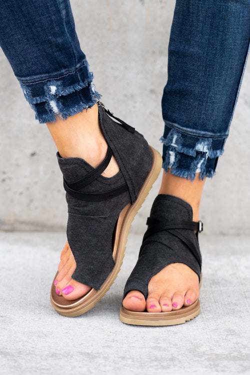 Strappy Sandal by Very G  These iconic boutique sandals from Very G are must have! Wear all spring/summer to add a little sass to your wardrobe.  Style Name: Scarlett Color: Black Cushioned foot bed Durable textured outsole Style #: VGSA0155 Contact us for any additional measurements or sizing.