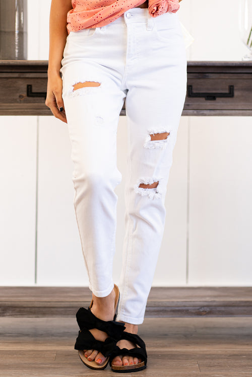 "Cello Jeans  Lean and legs-for-days sexy, our slim straight jeans will catch you off guard with comfort and style. Crafted with strategic distressing details that are not over the top. Collection: Spring 2021 Color: White Wash Cut: Straight Fit, 28"" Inseam Rolled Rise: High-Rise, 10.5"" Front Rise 93% Cotton 5% Polyester 2% Spandex Fly: Zipper Style #: WV77393SS Contact us for any additional measurements or sizing."