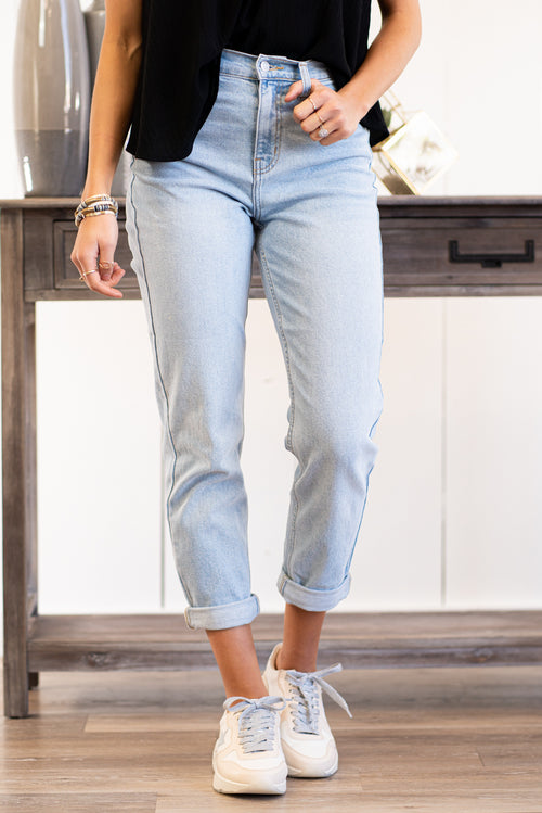 "Cello Jeans  Create a cute and casual look with our mom jeans. These must-have blue jeans are made from stretch cotton and boast a high-rise fit and a relaxed leg for a comfortable fit. Collection: Spring 2021 Color: Light Blue Wash Cut: Mom Skinny Fit, 25"" Inseam Rolled Rise: High-Rise, 11.5"" Front Rise 99% COTTON 1% SPANDEX Fly: Zipper Style #: WV76220LT Contact us for any additional measurements or sizing."