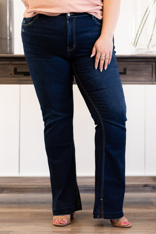 "KanCan Jeans Collection: Spring 2021 Color: Dark Blue Wash Cut: Flare, 33.75"" Inseam  Rise: Mid-Rise, 8.5"" Front Rise 64% COTTON 24% POLYESTER 10% RAYON 2% SPAN Fly: Zipper Fly Hem: Cut Hem Style #: KC7315D-PL Contact us for any additional measurements or sizing.   Victoria wears a 2XL top, 16W in jeans and a size 10 in shoes. She is wearing a 1XL in these shorts."