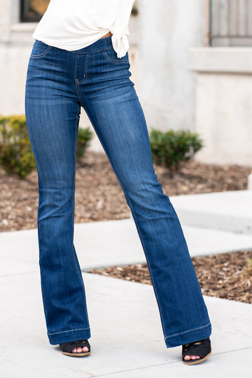"Cello Jeans Get comfortable and trendy in these ultra stretchy jeans. The dark wash flared jegging features a flattering flared fit, a faded wash, and light whisker detail. Additionally it has two faux front pockets and two back real pockets. Collection: Spring 2021 Pull On Flare  Color: Dark Blue Wash  Cut: Flare, 33"" Inseam Rise: Mid Rise, 8.5"" Front Rise 57% Cotton 26.4% Polyester 14.2% Rayon 2.4% Spandex Fly: Zipper Style #: AB35324DK Contact us for any additional measurements or sizing."