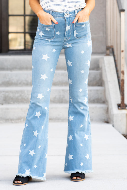 "Cello Jeans Be the STAR of the show with these high rise bell bottom flare jeans featuring star pattern and frayed hem. Additionally equipped with two pockets on back/front and no belt loops for creating a slimmer silhouette. Collection: Spring 2021 Super Flare Color: Medium Blue Wash  Cut: Flare, 33"" Inseam Rise: High-Rise, 11.5"" Front Rise 58% Cotton 16% Rayon 18% Polyester 5% T400 3% Lycra Fly: Zipper Style #: WV37354STA Contact us for any additional measurements or sizing."