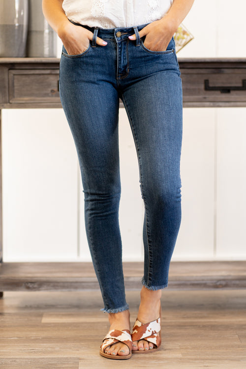 "Just USA Jeans  Color: Medium Blue Fringy Cut Hem  Cut: Skinny, 27"" Inseam Mid Rise, 8.5"" Front Rise   Stitching: Classic 97% COTTON / 3% SPANDEX Fly: Zipper Style #: JP987-MD Contact us for any additional measurements or sizing.  Haley wears a size small top, a 1 in jeans and a small in tops. She is wearing a size 2 in these jeans."