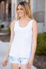 Thread & Supply  This classic burnout tank is perfect to throw on with any of your favorite bottoms! Super comfy and relaxed fit, featuring a scoop neck and small front pocket detail.  Color: White Neckline: Wide Sleeve: Sleeveless Pocket Tee 100% Linen  Style #: T1298LKTS-WH001 Contact us for any additional measurements or sizing.