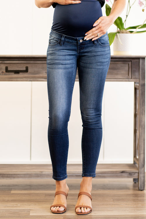"KanCan Maternity Jeans  Collection: Spring 2021 Color: Dark Blue Wash Cut: Skinny, 38.5"" Inseam Rise: Mid-Rise with Oversized Stretch Band, 5.25"" Material: 54% COTTON 34% RAYON 10% POLYESTER 2% SPANDEX  Style #: KC6274D Contact us for any sizing questions or measurements."