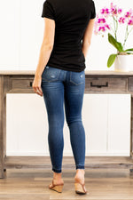"KanCan Maternity Jeans  Collection: Spring 2021 Color: Dark Wash Ripped Distressed Knee Released Hem Cut: Skinny, 29"" Inseam Rise: Mid-Rise with Stretch Bands, 7.25"" Material: 94% COTTON, 4% T-400, 2% SPANDEX Style #: KC3017D Contact us for any sizing questions or measurements."