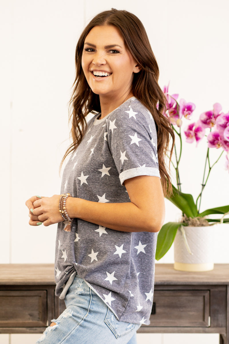 Hem & Thread   We love star print and this cozy top does not disappoint. Feel comfortable and cute in this oversized knit top.  Collection: Spring 2021 Color: Navy Blue Neckline: Round  Sleeve: Shorts Sleeve 70% RAYON 25% POLYESTER 5% SPANDEX Style #: 30773F-Navy Contact us for any additional measurements or sizing.