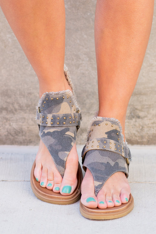 Zipper Sandal by Very G   These iconic boutique sandals from Very G are must have! Wear all spring/summer to add a little sass to your wardrobe. Style Name: Journey Color: Camo Green Hooded synthetic upper with braided criss cross cord detailing Back zip closure for easy on/off Cushioned foot bed Durable textured outsole Style #: VGSA0125-GreenCamo Contact us for any additional measurements or sizing.