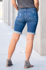 "Judy Blue Jeans Collection: Spring 2021 Color: Medium Blue Shorts  Cut: Bermudas Shorts, 9.75"" Inseam  Rise: 10.5"" Front Rise 94% Cotton / 5% Polyester / 1% Spandex Stitching: Classic  Fly: Zipper Fly Style #: JB150045-MD 