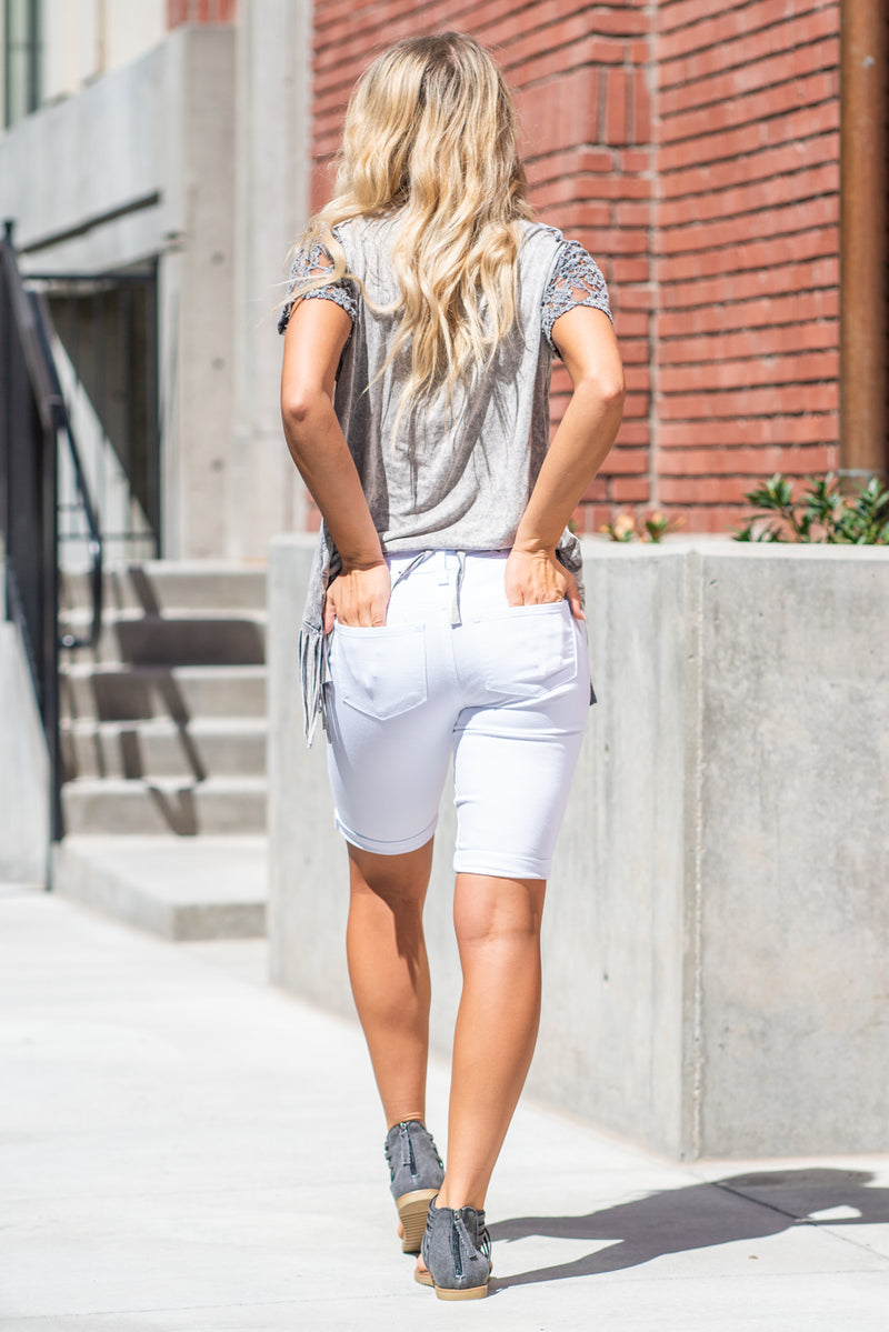 "KanCan Jeans With a good stretch and distressing these white shorts a great pairs with sandals and blouses for a dressed up summer look. Collection: Spring 2021 Color: White Cut: Bermudas Shorts, 11"" Inseam Rise: High Rise, 8.5"" Front Rise 65% COTTON 33% RAYON 2% SPANDEX Stitching: Classic Fly: Zipper Style #: KC6110WT Contact us for any additional measurements or sizing."