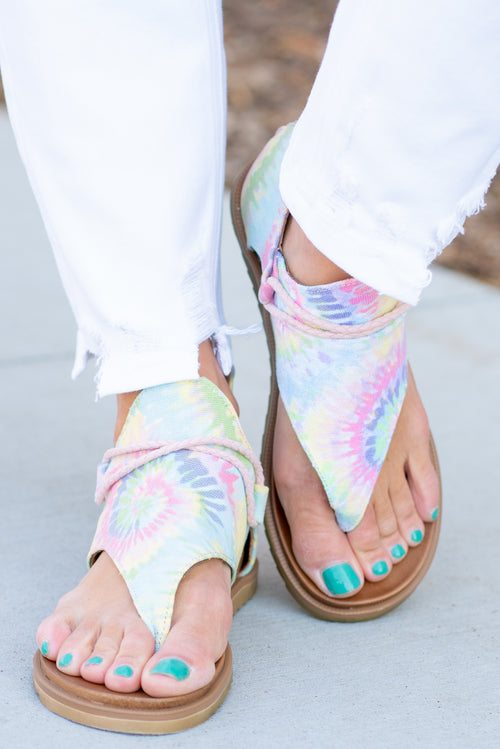 Zipper Sandal by Very G   These iconic boutique sandals from Very G are must have! Wear all spring/summer to add a little sass to your wardrobe. Style Name: Dusk Color: Pastel Tie Dye Hooded synthetic upper with braided criss cross cord detailing Back zip closure for easy on/off Cushioned foot bed Durable textured outsole Style #: VGSA0121-Pastel Contact us for any additional measurements or sizing.