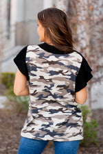 Blue Buttercup   The cutest Henley camouflage printed top. Pair with capris and sandals or shorts and tennies.  Collection: Spring 2021 Color: Black Mixed Neckline: V Henley Sleeve: Short   Style #: KT82334 Contact us for any additional measurements or sizing.