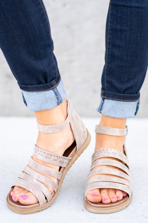 Strappy Sandal by Very G  These iconic boutique sandals from Very G are must have! Wear all spring/summer to add a little sass to your wardrobe.  Style Name: Commodus Color: Cream Cushioned foot bed Durable textured outsole Style #: VGSA0129 Contact us for any additional measurements or sizing.
