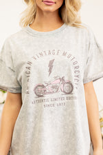 "Zutter  Are you apart of the vintage motorcycles club? Flaunt your sass in this cute graphic tee.  Collection: Fall 2020 Color: Grey Denim Neckline: Round Sleeve: Short Material: 100% Cotton Style #: K5738-1601 Contact us for any additional measurements or sizing.  Cas is 5'7"", wears size 25 jeans, a small top, and 8 shoes. She is wearing a size small in this top."