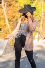 "Hem & Thread   This cozy belted cardi sweater can be paired a silk cami and black denim for a dressed up look or worn with your favorite joggers.  Collection: Fall 2020 Color: Blush Pink Neckline: Open Long Sleeve Cardi 74% ACRYLIC 22% POLYESTER 4% LYCRA Style #: 8443F Contact us for any additional measurements or sizing.  Taylor is 5'7"" and wears a size 3 in jeans, small top and an 8.5 in shoes. She is wearing a size small in this sweater."