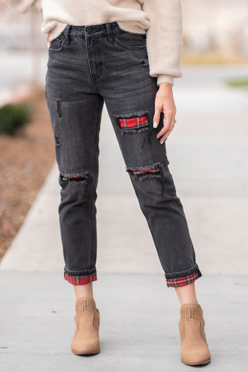 "KanCan Jeans  Collection: Fall 2020  Color: Black Wash Cut: Straight Cut, 27"" Inseam Rise: High-Rise, 10.5"" Front Rise Material: COTTON 74% POLYESTER 26% Detail: Slightly Distressed Whisker Wash & Buffalo Plaid Patch Fly: Zipper Fly Style #: KC6337BK  Contact us for any additional measurements or sizing.  Chloe is 5'8"" and 130 pounds. She wears a size 26 in jeans, a small top and 8.5 in shoes. She is wearing a 26 in these jeans."