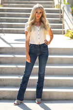 "Just USA Jeans  Color: Dark Wash Boot cut, 32"" Inseam Rise: High Rise, 10"" Front Rise Machine Wash Separately In Cold Water Stitching: Classic Fly: Zipper Style #: JP069 Contact us for any additional measurements or sizing.  Haley wears a size small top, a 25 in jeans and a small in tops. She is wearing a size 4 in these jeans"