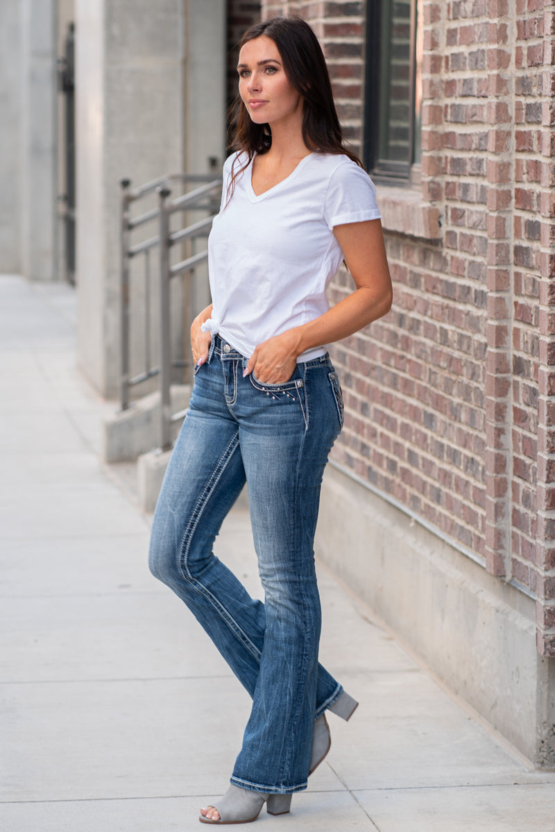 "Miss Me Collection: Fall 2020 Wash: Medium Blue Inseam: 34"" Boot Cut 99% Cotton 1% Elastane Mid Rise, 8.75"" Front Rise Embellished Silver Totem Angel Pocket Style #: M3652B Contact us for any additional measurements or sizing."
