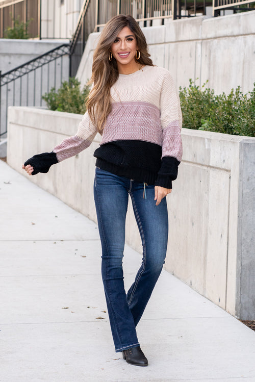 "Miss Sparkling  Sweater up girl, its getting cold outside. This color block sweater is too cute paired with ankle booties and skinny jeans.  Collection: Winter 2020 Color: Color Block - Black, Cream & Mauve Neckline: Round Neck Sleeve: Long Sleeve 100%Acrylic Style #: US00047-Colorblock Contact us for any additional measurements or sizing.  Taylor is 5'7"" and wears a size 4 in jeans, small top and an 8.5 in shoes. She is wearing a size small in this sweater."
