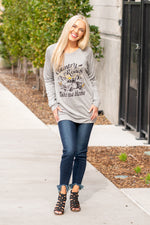 "Zutter  Country Road, take me home. This cute graphic pull over will be the coziest piece in your closet.  Collection: Fall 2020 Color: Grey Neck: Round Sleeve: Long Sleeves Material: French Terry, 95% Rayon 5% Spandex Style #: F246-7219-GREY Contact us for any additional measurements or sizing.  Melissa is 5'5"" and wears a 2 in jeans, small top and size 6 shoe. She is wearing a size small in this top."