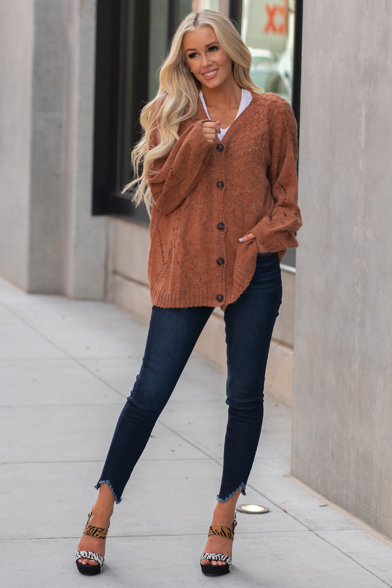 Miss Me  Collection: Fall 2020 Cozy Up Color: Ginger Brown Neckline: Round Sleeve: Bell Sleeve Style #: MSW0179L Contact us for any additional measurements or sizing.  Haley wears a size small top, a 3 in jeans and a small in tops. She is wearing a size small in this sweater.