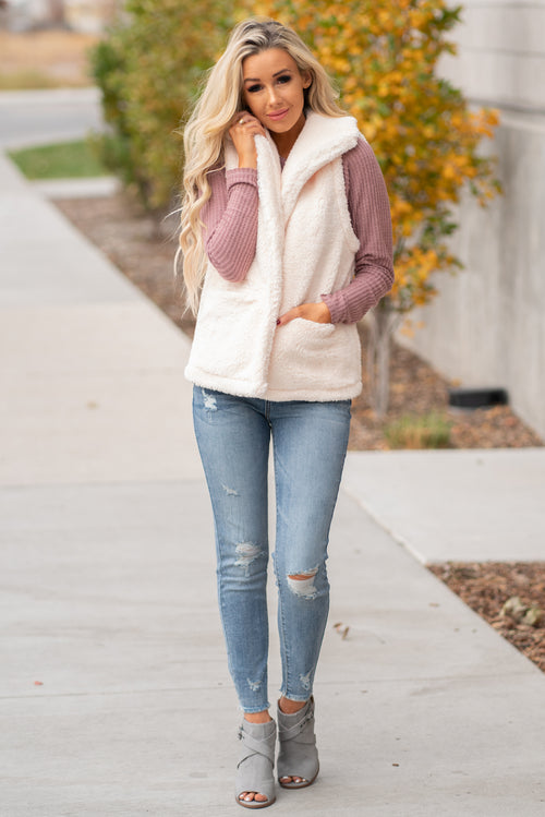 Hem & Thread   Feel cozy and cute in the sherpa vest. Pair with a great boyfriend denim in heels for a trendy fun look.  Collection: Fall 2020 Color: Cream Neckline: Open Fit: Vest 100% POLYESTER  Style #: 30078 Contact us for any additional measurements or sizing.  Haley wears a size small top, a 3 in jeans and a small in tops. She is wearing a size small in this vest.