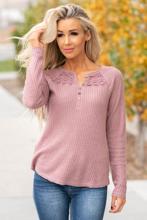 Hem & Thread   This cozy stone long sleeve thermal Henley top is perfect to layer with cozy sweaters and paired with denim.   Collection: Fall 2020 Color: Mauve Neckline: Round  Sleeve: Long Sleeve 95% POLYESTER 5% SPANDEX Style #: 8469J-Mauve Contact us for any additional measurements or sizing.  Haley wears a size small top, a 3 in jeans and a small in tops. She is wearing a size small in this top.