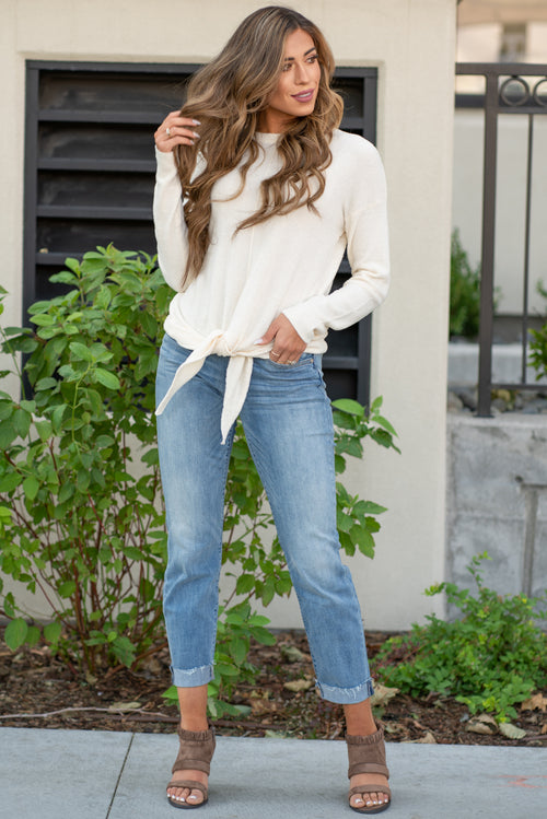 "Hem & Thread   This pull over top is perfect to keep you warm and cute. Pair with a great mid rise denim and heels for an easy look.  Collection: Fall 2020 Color: Ivory White Neckline: Crew Round Long Sleeve 100% Fuzzy Nylon Style #: 7487IV Contact us for any additional measurements or sizing.  Taylor is 5'7"" and wears a size 3 in jeans, small top and an 8.5 in shoes. She is wearing a size small in this sweater."