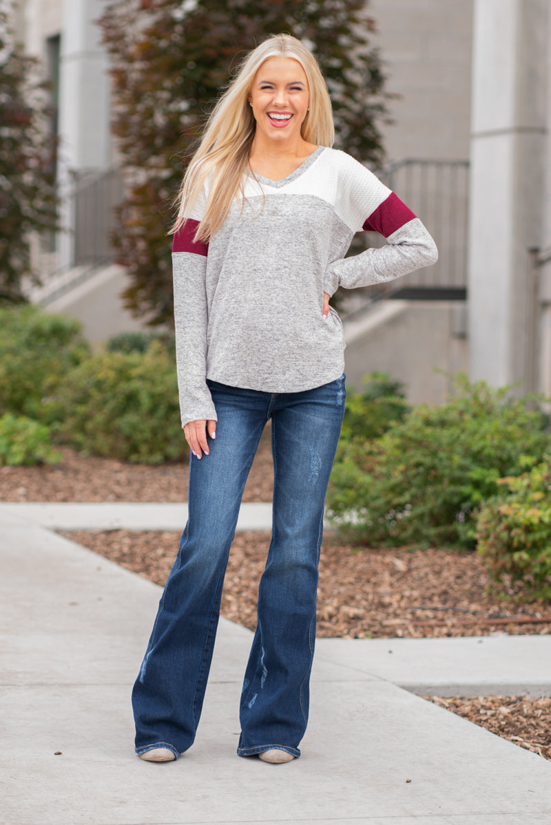 "Hem & Thread   This long sleeve thermal top will keep you warm paired with your favorite denim and warm boots.  Collection: Fall 2020 Color: Grey Neckline: V-Beck  Sleeve: Long Sleeve 74% RAYON 22% POLYESTER 4% SPANDEX Style #: 8314-Maroon Contact us for any additional measurements or sizing.  Melissa is 5'5"" and wears a 2 in jeans, small top and size 6 shoe. She is wearing a size small in this top."