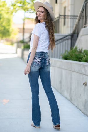 "Miss Me  Collection: Spring 2020 Style Name: Americana Angel Color: Dark Wash 92% Cotton 6% Lyocell 2% Elastane Cut: Slim Boot Cut, 34"" Inseam Rise: Mid-Rise, 8.75"" Front Rise Style #: M3561SB"