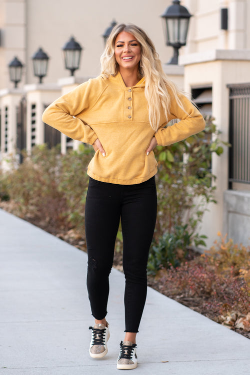 "Hem & Thread   Button down hoodie jacket. Pair with skinny jeans and cute tennis shoes for an easy going look.   Collection: Winter 2020 Color: Mustard Yellow Neckline: Collard with a Zipper front Sleeve: Long 80% POLYESTER 20% COTTON Style #: 8342J Contact us for any additional measurements or sizing.  Cas is 5'7"", wears a size 25 jeans, small top and 8 shoe. She is wearing a size small in this hoodie."