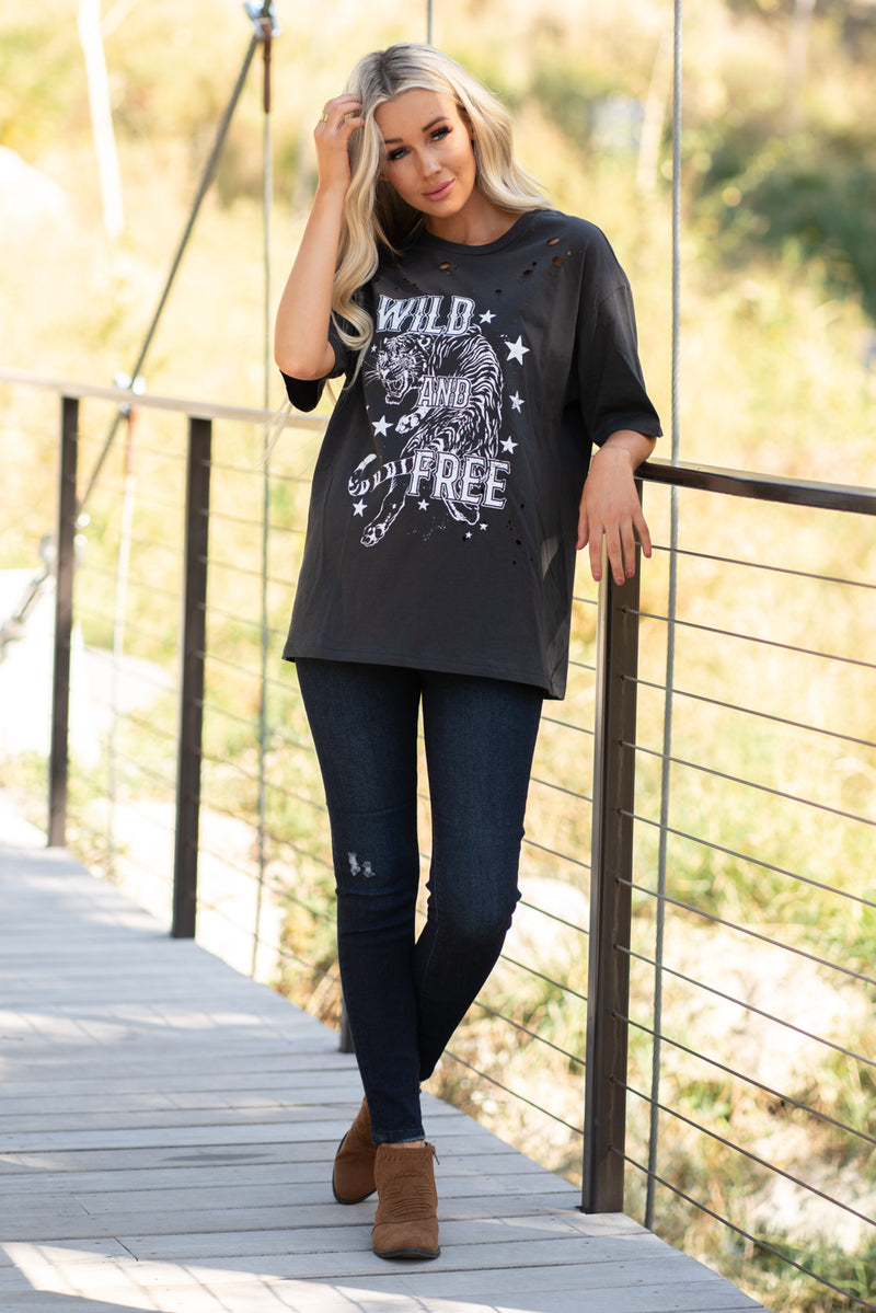 Zutter  Wild & Free my Tiger Queen. Wear this burnout distress top with any denim.  Collection: Fall 2020 Color: Black Neckline: Round Sleeve: Short Material: Rayon95% Span5% Style #: F525-1161 Contact us for any additional measurements or sizing.  Haley wears a size small top, a 3 in jeans and a small in tops. She is wearing a size small in this top.