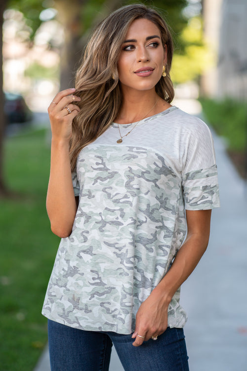 Hem & Thread   Camo is all the rage right now and this feminine top is perfect for your everyday wear. Wear this cute pocket tee with all your favorite denim!  Collection: Summer 2020 Color: Camo & White Neckline: Round-Neck Sleeve: Short 55% RAYON 45% POLYESTER -CONTRAST:94% POLYESTER 6% SPANDEX Style #: 6441W