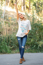 Zutter  Wear this burnout distress top with any denim.  Collection: Fall 2020 Color: Khaki  Neckline: Round Sleeve: Short Material: 100% Cotton Style #: F525-1271 Contact us for any additional measurements or sizing.  Haley wears a size small top, a 3 in jeans and a small in tops. She is wearing a size small in this top.