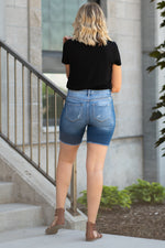 "High Rise Boyfriend Shorts By Kan Can  Collection: Summer 2020 Boyfriend Shorts High Rise waist, 10"" Front Rise High Shorts, 7"" Inseam Medium Wash Material: 95% COTTON / 4% POLYESTER / 1% LYCRA Stitching: Classic Fly: Exposed Button Fly Style #: KC8583M"
