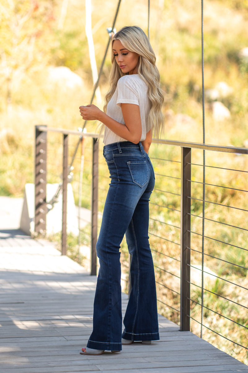 "KanCan Jeans  Collection: Fall 2020 Skinny, 34"" Inseam with Cuffed Ankles High Rise, 11"" Front Rise Dark Blue Wash  COTTON 79.6% POLYESTER 18.8% SPANDEX 1.6% Fly: Exposed Button Fly Style #: KC7339D Contact us for any additional measurements or sizing.  Haley wears a size small top, a 3 in jeans and a small in tops. She is wearing a size 25 in these jeans"