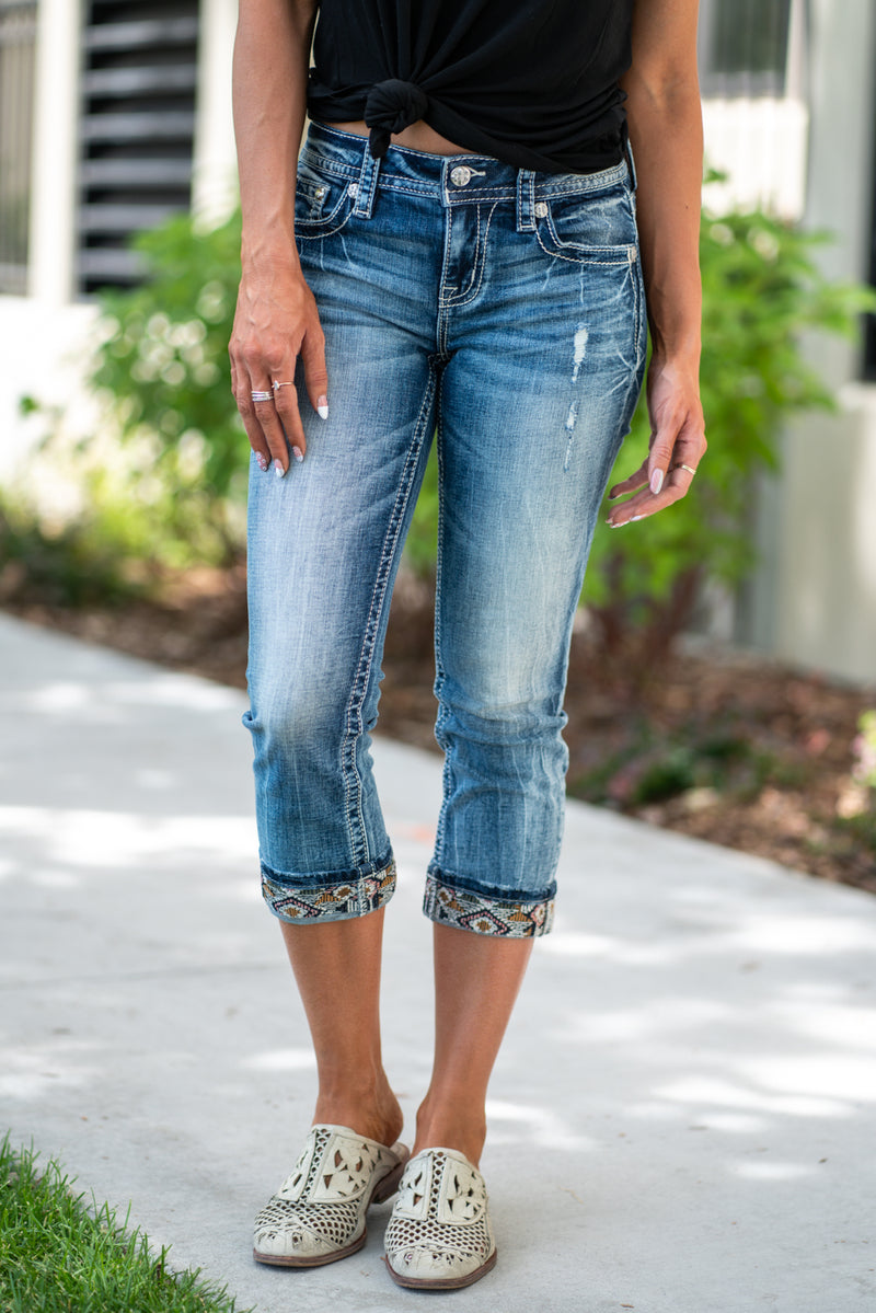 "Miss Me Jeans Collection: Summer 2020 Name: Americana Capris Color: Medium Wash Cut: Shorts, 23.5"" Inseam Rise: Mid Rise, 8.75"" Front Rise 99% COTTON / 1% SPANDEX Stitching: Classic Fly: Zipper Style #:  M3600P"