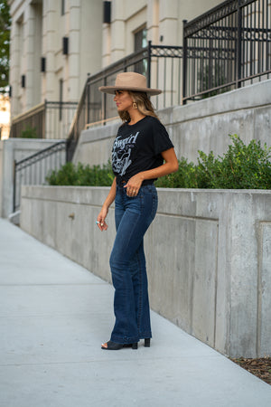 "Miss Me  The Heaven collection from Miss Me features a clean look with small embellished details.  Collection: Fall 2020 Wash: Dark Blue Inseam: 34"" Boot Cut 96% Cotton; 3% Polyester; 1% Elastane Mid Rise, 8.75"" Front Rise Small Embellished Details Style #: M3636B4 Contact us for any additional measurements or sizing.  Taylor is 5'7"" and wears a size 3 in jeans, small top and an 8.5 in shoes. She is wearing a size 25 in these jeans."