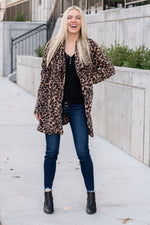 "Miss Sparkling  Stay warm this winter with the cutest open fleece coat in leopard print.  Collection: Winter 2020 Color: Tan- Leopard Print Neckline: Open Sleeve: Long Sleeve 100% Polyester Style #: O205094 Contact us for any additional measurements or sizing.  Melissa is 5'5"" and wears a 0 in jeans, small top and size 6 shoe. She is wearing a size small in this jacket."